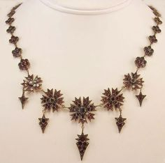 Victorian garnet necklace featuring flowers and arrows
