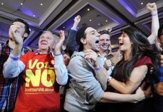 Pro-union supporters celebrate as Scottish independence referendum results are announced at a 'Better Together' event in Glasgow, Scotland. Scots had settled in for a long night of counting ballots, awaiting a result that could have remapped Great Britain, shaken up global financial markets and altered the geopolitical landscape of northern Europe.