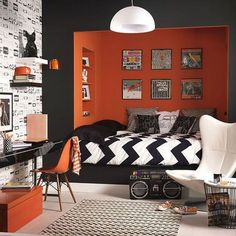 Modern Teenage Boy Bedroom With Orange Black Wall Color And Wallpaper And Using Chevron Comforter