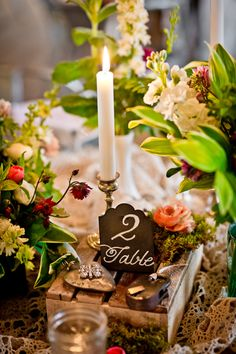 centerpieces with a vintage garden touch // photo by Swoon Over It // View more: http://ruffledblog.com/romantic-terrain-wedding/