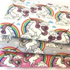 Rainbows & unicorns silver coloured 100% cotton poplin fabric