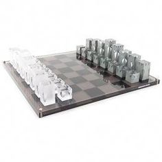Add glamour to the home with this chess set from Jonathan Adler. Made entirely of acrylic, it is screen printed and includes full sets of grey and white playing pieces. Ideal as a permanent display. Coffee Table Games, Coffee Table Design, Decorating Coffee Tables, Jonathan Adler, Modern Chess Set, Acrylic Board, Chess Pieces, Game Pieces, Mid Century Modern Furniture