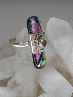 """This handmade artisan Dichroic Glass ring accented with an oval faceted Lemon Citrine gemstione, set in 925-hallmarked sterling silver. Length: 1.25"""" Width: .4"""" Ring size: 5.5 - 6"""