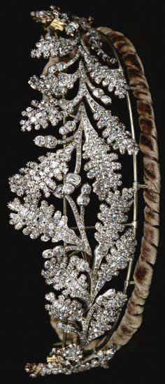 Diamond tiara, Early 19th Century. Designed as two confronting sprays of oak leaves tapering from the centre, set throughout with old mine diamonds, accompanied by fitted case stamped Carrington & Co. Jewellers, 130 Regent St., London .W. May also be worn as four brooches, one diamond deficient
