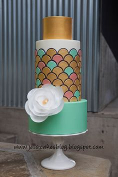 Jessica Harris art deco (scallops) cake I made with a wafer paper flower.