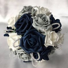 Navy Blue and Grey Fall Wedding Color Inspiration: White bride and navy bridesmaids, groom and groomsmen in navy vests and grey suits with navy ties , navy and grey wedding cakes, white table linens and navy napkins… Navy Silver Wedding, Grey Wedding Theme, Navy Wedding Flowers, Prom Flowers, Fall Wedding Colors, Autumn Wedding, Gray And Navy Blue Wedding, Navy Blue Wedding Cakes, Navy Flowers