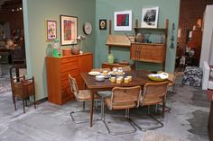 Mid Century and Danish Modern furnishings, including a group of chrome and cane Cesca chairs, wall mounted storage, interesting vintage art and accessories.