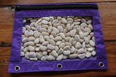sight words written on beans inside a pencil bag. Shake and read the words that pop up--could also use with letters, numbers, etc..