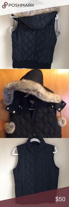 Ann Taylor LOFT Puffy Vest Cozy, pre-loved, black puffy vest. The hood with faux fur trim is detachable. See picture for down/polyester makeup. Slight pilling on back waist but only noticeable close up. LOFT Jackets & Coats Vests