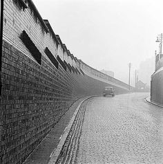 Cobbled street in Camden, London, England, United Kingdom, 1963, photograph by John Gay.