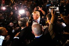 LIE UPON LIE UPON LIE UPON LIE --  Donald Trump surrounded by reporters at the first prime-time presidential debate at the Quicken Loans Arena in Cleveland, August 2015. By Scott Olson/Getty Images.