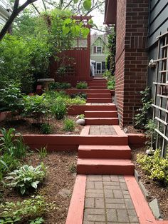 The freshly painted steps and 6x6 ties that frame the terraced garden areas to the side of this South Orange, NJ home make this a very cool space