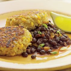 These crispy fried patties get a swift kick from the easy-to-make bean-and-salsa accompaniment. Instant brown rice only takes about 10 minutes, a great shortcut on a busy night. Garnish with sour cream and scallions.