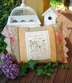 """""""Singing Bird"""" by Sally Giblin of The Rivendale Collection. Verse reads: Keep a green tree in your heart... and perhaps a singing bird will come. Finished cushion size: 14 ½ """" x 23"""""""