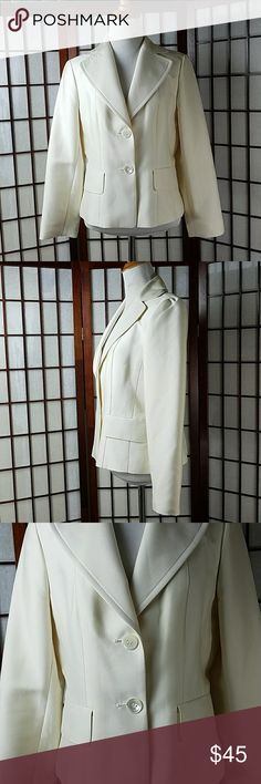 "Ann Taylor Lined Blazer Size 6 Pre-owned excellent condition no issues  Ann Taylor Size 6 Blazer Lined light cream color/ ivory color Solid pattern  2 Faux pockets 2 buttons made of 58% silk and 42% will  (shell), 55% acetate and 45% rayon (lining)  Measurement Approximate Pit to pit 18.5"" Shoulder to hem 22.5"" Ann Taylor Jackets & Coats Blazers"