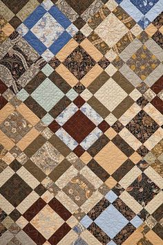 using William Morris reproduction fabrics for a nine-patch quilt.