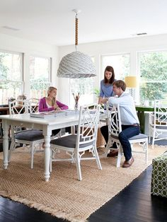 Room for Everything: by transforming a large sunroom into a studio, the homeowner carved out crafting and homework space for the family. The large table, which used to be in the kitchen, thrifted chairs and a rope-covered pendant light were updated with coats of white paint -- an easy way to unify mismatched items.