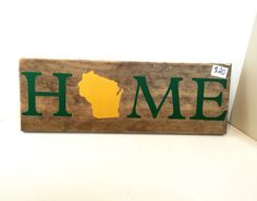 A personal favorite from my Etsy shop https://www.etsy.com/listing/258062014/wisconsin-home-green-bay-packer-colors