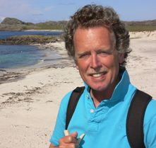 Our beloved author on the beaches of Iona