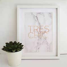 A stylish marble print with gold foil featuring the phrase 'TRES CHIC'.Available in three sizes A4, A3, A2 Framed or unframedThis contemporary print would suit most interiors with the muted tones and classic, minimal design. Featuring both marble and gold this print encorporates two of the biggest trends this season making it a stunning additon to your home or a beautiful gift for someone special. Printed with a top of the range Giclee printer on quality matte poster paper (230 gsm)…