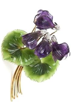 An 18k Yellow Gold, Diamond, Carved Amethyst and Carved Jade Violet Flower Brooch.: