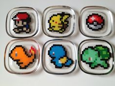 Pokemon costers made from perler beads encased in epoxy resin