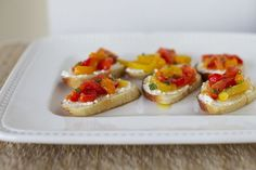 People always ask me for this recipe. So easy but so good! Goat Cheese with Bell Pepper Dressing http://www.epicurious.com/recipes/food/views/Goat-Cheese-with-Bell-Pepper-Dressing-1524