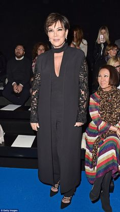 Proud momager: Kris Jenner avidly watched her daughter Kendall take to the runway at theElie Saab Paris Fashion Week show on Saturday