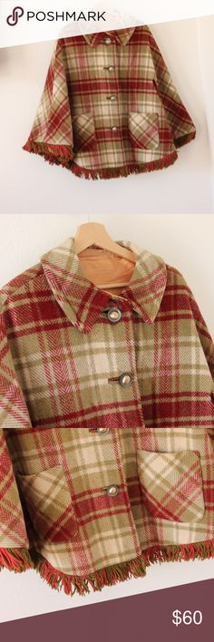 Vintage Wool Cape/ Poncho gorgeous vintage plaid wool cape with fringe at the bottom. in great condition, but has some scuffs on the buttons and a tiiny tear near one of the arm holes(pictured). no size tags, but will fit any size Vintage Jackets & Coats