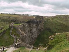 Tintagel Castle (Cornish: Castel Dyntagell) is a medieval fortification located on the peninsula of Tintagel Island, adjacent to the village of Tintagel in Cornwall, England, in the United Kingdom.