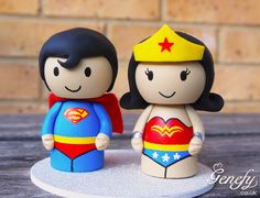 Superman and Wonder Woman wedding cake topper  https://www.facebook.com/genefyplayground