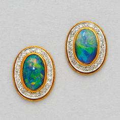 Black Opal, Diamond and 18K Gold Earrings   Set with a pair of black opal measuring approximately 12.0 mm by 7.5 mm, framed by small round diamonds
