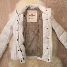 Hollister white fur lined parka Barley worn great condition. Just missing the hood. Size small. Hollister Jackets & Coats Puffers