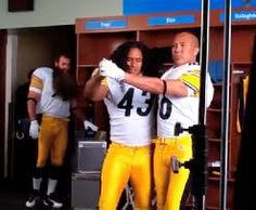 Hines teaching Polamalu the tango, while Keisel looks on (during filming of Head and Shoulders commercial-hence Keisel's fake beard).