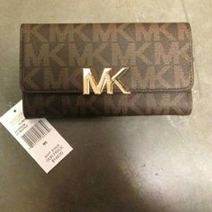 Michael Kors Billfold Wallet Michael Kors brown monogram large billfold wallet New with tags! 100% authentic No trades No Holds Michael Kors Bags Wallets