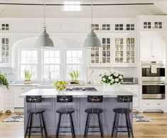 Clean and fresh kitchen with grey-blue island and stool seating. large pendants. Double oven. Kitchen inspo. Home decor. interior decorating