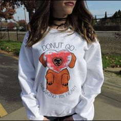 """Dachshund Wiener Dog Donut Crewneck Sweatshirt Calling all donut lovas!   Rock this Dachshund pill-restitant crewneck sweatshirt features """"Donut Go Breaking My Heart"""" screen printing on a white sweatshirt. This animal dog sweatshirt is comfortable and true to size. Model is 5'2 wearing a small. Grab one before they're gone!     PRODUCT MEASUREMENTS S --- 26-20-33 M --- 27-22-34 L --- 28-24-35   CONTENT + CARE INSTRUCTIONS 50% cotton, 50% polyester Machine wash cold Do not bleach Do not iron…"""