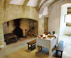 Fireplace - a real cooking fireplace - a typically medieval kitchen - use stone and white or cream paint to get this look while keeping it light and airy in your home