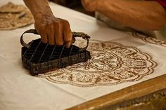 Batik - Process of stamping wax designs on fabric.