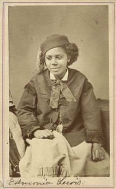 Carte-de-visite portrait of Edmonia Lewis (1845-1890), African American Sculptor. Lewis, the first famous American sculptor of African descent, had a Chippewa mother and a free black father. After being orphaned at age twelve, she was adopted by abolitionist parents and eventually developed into an accomplished Neo-classical sculptor. While in Rome, she worked and exhibited with the likes of Harriet Hosmer. #Victorian #women #artists