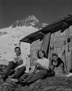 Skiers eating and relaxing al fresco in the Alps.