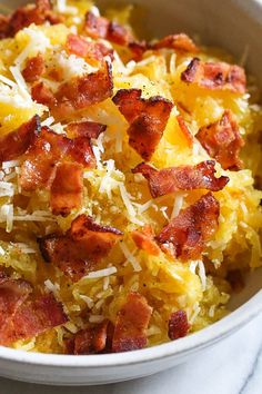 Roasted spaghetti squash with bacon and Parmesan cheese is a great way to top spaghetti squash for an easy, tasty, low-carb side dish. Although there are several methods to cook spaghetti squash, my favorite way to make it is roasted. To roast the squash, I cut it on half lengthwise, remove the seeds and cook it cut down for about one hour.