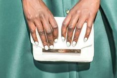 Kate Spade clutch and white striped nails