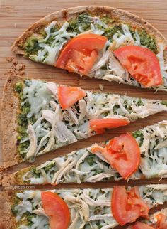 These healthy and delicious Chicken Pesto Flatbreads boast a thin, crispy crust, flavorful pesto, hearty chicken, Mozzarella cheese and juicy tomatoes! All the flavors you crave for just 282 calories or 7 Weight Watchers SmartPoints! www.emilybites.com #healthy