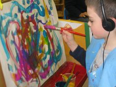 I love to set up provocations for creativity expression with art.  Music is a great one. With headphones and music the children can be carried away. It also can be a very calming activity when someone is upset.  I put a old cd player near the easel with headphones and classical music and let it happen.