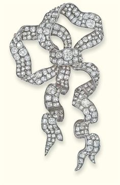 AN ANTIQUE DIAMOND BROOCH  Designed as an articulated pavé-set old-cut diamond curled ribbon bow, mounted in silver and gold, circa 1890, 8.2 cm long