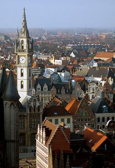 Guildhouses and clock tower, Ghent by Jackie5, via Flickr