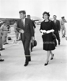 President John F. Kennedy and Jacqueline Kennedy walk to their plane at Andrews Air Force Base near Washington on May 16, 1961. They are flying to Ottawa on a goodwill mission to Canada. This is Kennedy's first trip outside the United States since his inauguration. (AP Photo)