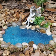 Cute fairy relaxing by the pond