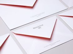Envelope design with spot colour interior by Base Design for high-end jewellery brand, expert watchmaker and retailer Maison De Greef 1848